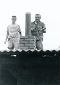 Stanislav Balík and František Pecháček working on the roof the the Scout centre in Bludov