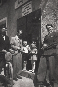 Uncle Jan Urban, on the right, in front of a general store (the name of the store is written both in Czech and in German)