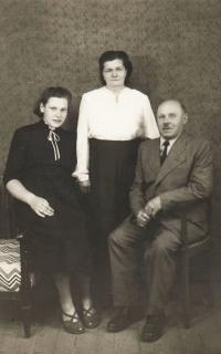 With her (adoptive) parents Emilie and Čeněk Zlámalovi