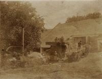 By a threshing machine in Slížany