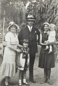 Zdislava Kodešová with her parents, older sister and maid (1931)
