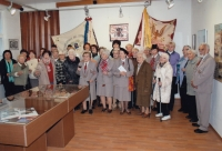 Exhibition in honor of 130 years of Sokol in the Blatsko Museum. Helena Zvánovcová is centered with a glass of wine.