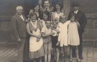 Eva in front of the railway station in Ústí nad Orlicí with her family, 1933