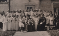 Vlasta Vaňoučková with her schoolmates in front of a presbytery - second from the left in the second row, 1940s