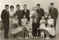 Miroslav Jeník and his wife Milada (both at the very top left) in a photo from the wedding, which was not theirs