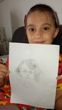 Emma Pedrotti, on of the author´s team of Scuola ceca showing the pictoru of Trudy, which she drew within the project