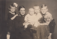 With her mother and siblings, Helena on the left