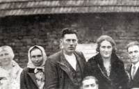 Father Karel Novák is in the middle, his mother Barbora Nováková is on his right