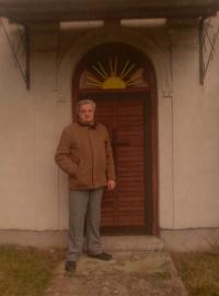 Josef Zíka in front of a Šumava church