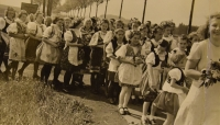 Prime divine service June 4, 1944, the parade of young people in the costumes