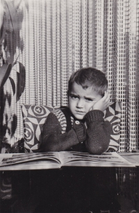 Little Miloš with a book, at home 1953