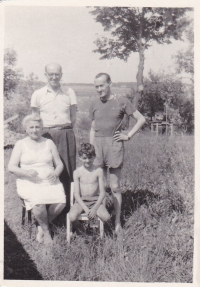 His grandmother is sitting on the left, above her is his grandfather (the parents of his mother), Miloš is sitting below his father, Prague 1956