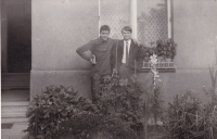 Miloš with a friend from Romania in front of his house, Smíchov, 1966