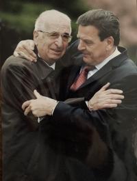 Father Tomáš Kosta with Gerhard Schröder inTerezín, 2005