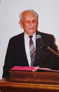 Lay preacher Vlastislav Maláč at the pulpit of the ECM Church Headquarters, Prague 1996