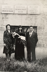 Helena Aková with husband and daughter during graduation ceremony