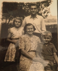 With his parents and sister