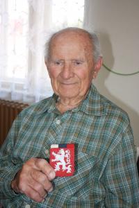 Jiří Boháč with a handmade national emblem
