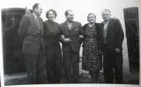 With parents and friends in 1960