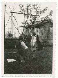 Dagmar with her sister as children, performing a tale