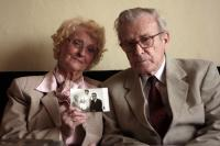 Pavel Oliva and his wife Věra Olivová with an archive family photo (2011)