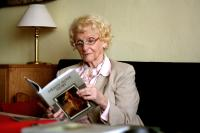 """Věra Olivová with her book """"Dějiny nové doby"""""""