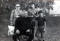 with husband and kids (60s ?)