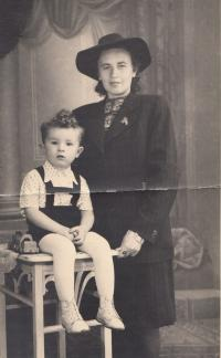 With his mum; 1945