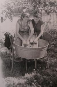 Laundering in wash-tub with sister