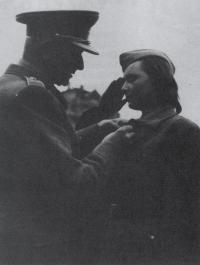 Ludvík Svoboda is decorating Marie Králová in Prague, 1945