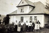 The Drong family in front of the house in Mosty u Jablunkova
