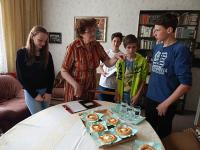 ms. Ingeborg Casarová with children from oral history project Stories of ourneighbors