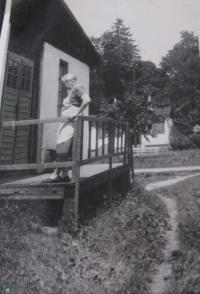 Her mother Emílie Przybylová in front of the quarters in the internment camp in Mohelnice