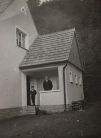 Father and brother in font of parents' house (1920s)