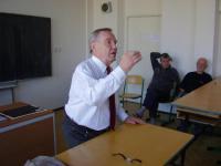 Strauch speaking at a lecture at the Archbishop grammar school in Prague