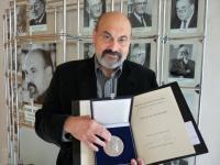 Tomáš Halík with the Gurdini prize in 2010