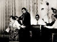 During performance with the band in 70´s