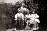 Erika Friedová and friends wearing folk costumes