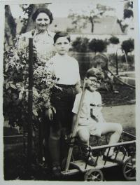 Tom with mother and younger brother