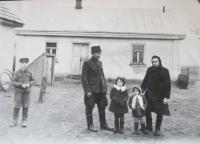 Lucuk family in front of the house in Podlísky (on the left the cover of the cellar where the family was hiding during the air raids and her father was hiding there during the arrival of the armies)