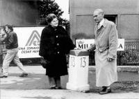 Mr. and Mrs. Haluza by the Běchovice milepost