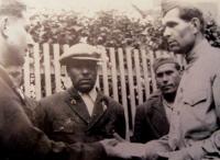 His brother Vratislav Svačina, member of the partisan group Miroslav Tyrš shakes hands with the group leader Ivan Andreyevich Libunski