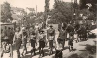Scouts march through the streets Slansky