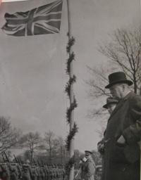 Winston Churchill and Edvard Beneš standing at the flag of Great Britain