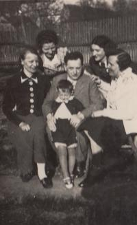 1937; with his father and family