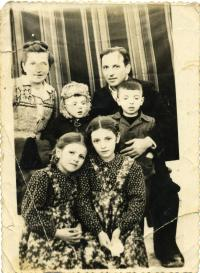 At time of exile. Stand: Mrs. Maria Mykytka, Yurij, Fr. Markiyan, and son Orest. Sit: daughters Aniziya and Lyubomira. Special settlement Kuchi, Khabarovsk krai in the Far East of the USSR, 1953.