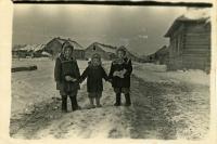 At time of exile. Children of Fr. Markiyan Mykytky in front of barracks - Lyubomyra, Orest, and Aniziya. Special settlement Kuchi, Khabarovsk krai 1953.