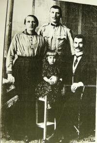 with parents, father in the middle