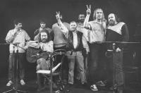 A performance in Wroclaw in 1989; from the left: Pavel Dobeš, Pepa Nos, Jaroslav Hutka, Petr Dopita, Karel Kryl, Petr Rímský, Jarek Nohavica, Vladimír Veit, and Pepa Streichl