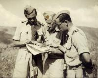 Instructors consult together (Josef Hercz on the left)